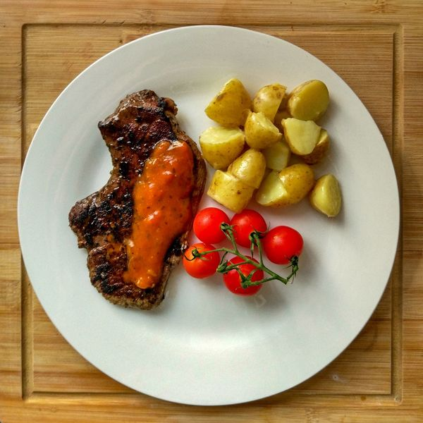 Meal. Tomato Fruit Sauce Steak Sauce Beef Steaks Potato colour of life Colourful Colorful Balanced Fruit Plate Directly Above Table Close-up Food And Drink Serving Dish Prepared Food Cooked Serving Size Served Food Styling Food State Appetizer