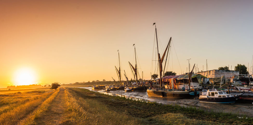Faversham Creek, Faversham, Kent Faversham Creek Kent Thames Barge United Kingdom Faversham Harbor House Boat Marina Mast Mode Of Transportation Moored Nautical Vessel Orange Color Red Sail River River Bank  Sailboat Sunlight Sunrise Sunset Tide Tranquility Transportation Travel Destinations Water