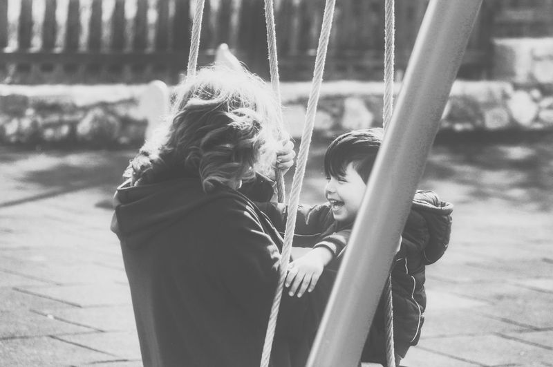 Blackandwhite Happiness Childhood Real People Leisure Activity Kids Being Kids Love Family Time Happiness Quality Time Swinging Child Fun Capture The Moment Cheerful Enjoying Life Having Fun Playground Togetherness Boys Swing Outdoors Grandmother Second Acts Leisure Time