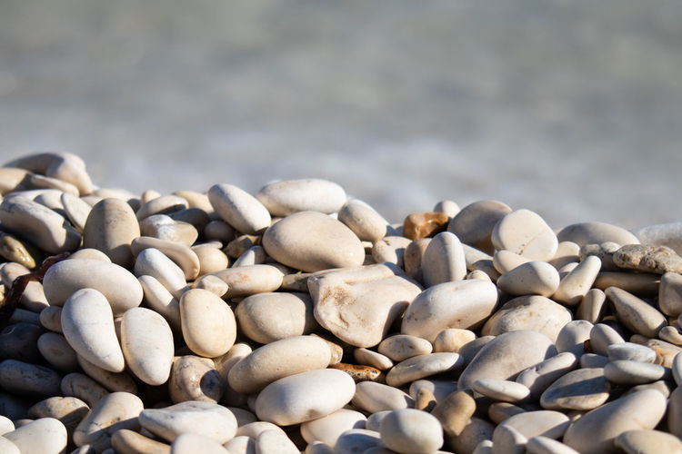 Rock Stone Pebble Stone - Object Solid Large Group Of Objects No People Nature Abundance Close-up Day Rock - Object Beach Still Life Land Focus On Foreground High Angle View Outdoors Selective Focus Beauty In Nature Pier Galets Galette Plage