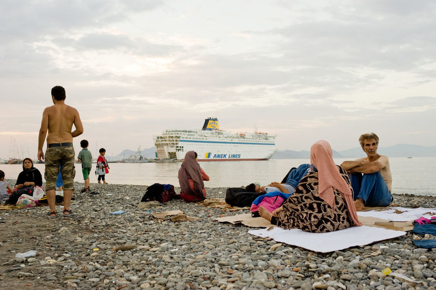 Refugees resting on the beach and waiting for transfer on 15 August 2015, Kos, Greece Aegean Sea Beach Crisis Europe Family Greece Kos Migrants Refugees Resting Syrian Telling Stories Differently