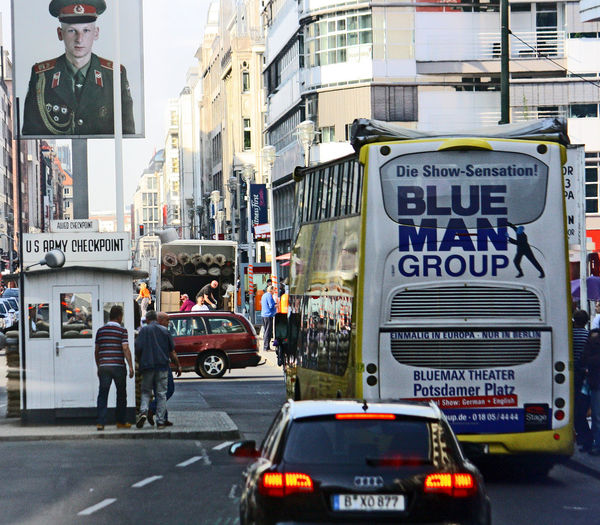 A Taste Of Berlin Checkpoint Charlie  Russian Soldier Adult Architecture Building Exterior Built Structure Car City Day Men Outdoors People Road Street Text Transportation #urbanana: The Urban Playground
