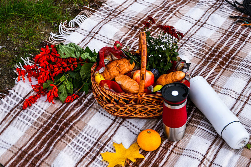 High angle view of red chili peppers in basket on table