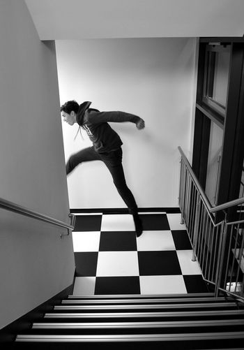 hotelfloor Blackandwhite Photography Staircase Stairs Portrait Photography Bnw_friday_eyeemchallenge Portrait Jumper Bnw_collection Bnw Noir Noir Et Blanc Black And White Pattern Chess Blackandwhite EyeEm Ready   Full Length Skill  One Person Adult Sport RISK Agility Jumping Athlete Stories From The City The Creative - 2018 EyeEm Awards The Modern Professional Capture Tomorrow Moments Of Happiness 2018 In One Photograph