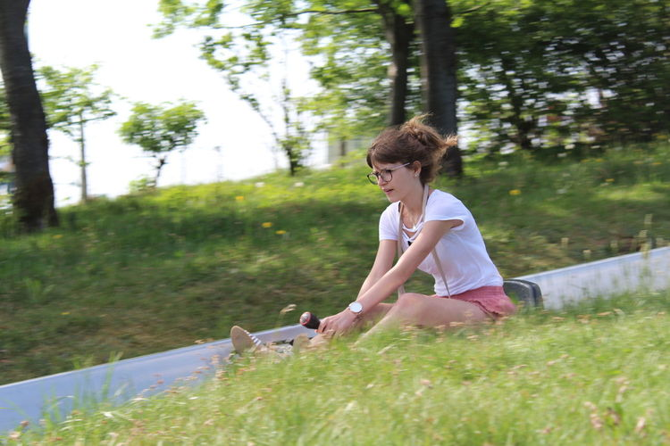 Full length of woman on grassy field