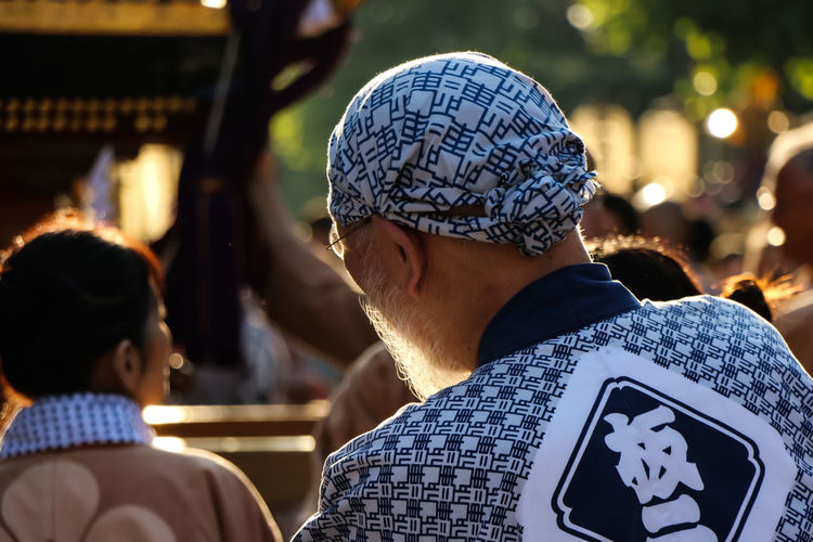 Rear view of man standing in japanese festival