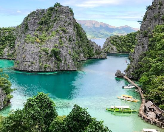 One of the prettiest places I've ever seen. Water Scenics Beauty In Nature Mountain Tourism Travel Nature Tranquil Scene Travel Destinations Idyllic Nautical Vessel Cliff Sea No People Sky Outdoors Tranquility Day ASIA Lakes  Blue Peaceful Secluded  Palawan Philippines