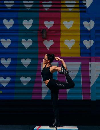 - Stand for Love Love Yoga Nycphotographer EyeEm Best Shots EyeEm Travcimages eyeemphoto Eye4photography  EyeEm Gallery Visual Creativity Composition Yoga Pose Women Indoors  Creativity Standing Flexibility