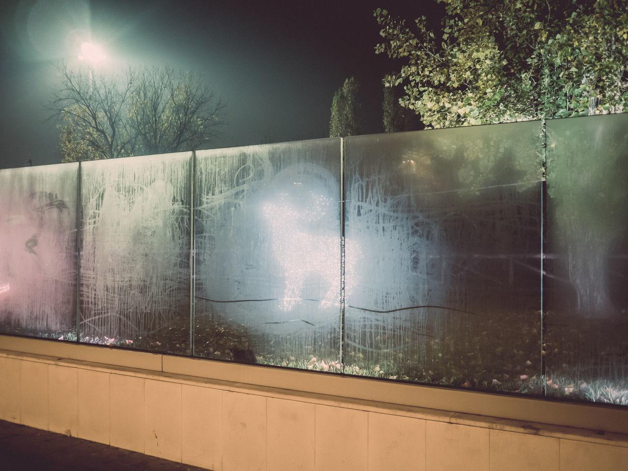 VIEW OF ILLUMINATED WINDOW IN NIGHT