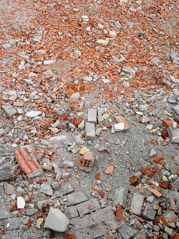 Gray and orange construction site debris Backgrounds Close-up Construction Construction Site Construction Work Day Debris Detritus No People Outdoors Refuse Residue Rubble
