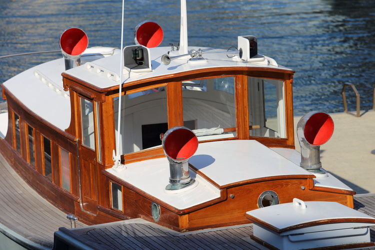 Restored, a labour of love Marine Vessel Old Boat Boat Deck Boat, Cabin Cowl Day Helm Motor Boat Nautical Vessel Navigation Lights Navigational Compass Outdoors Pilot Boat Pleasure Craft Restored Sea Tug Boat Varnished Vessel Water Windows Wood - Material Wooden Yacht