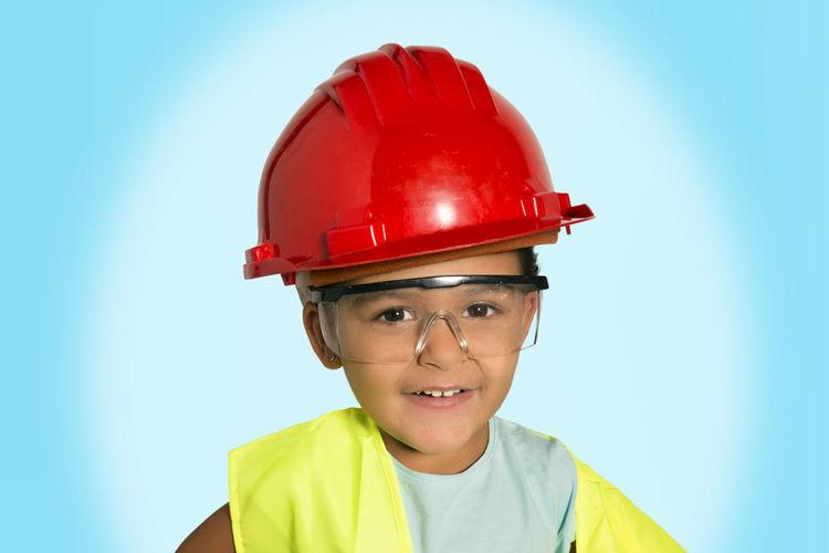 Portrait of boy wearing hat against blue sky