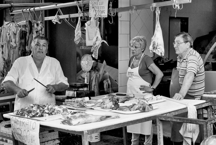 sharpen a knife Food Market Real People Standing Table Catania Travel Street Streetphotography Street Photography Black And White Sharpen Retail  Tourism Knife Skill  Group Of People