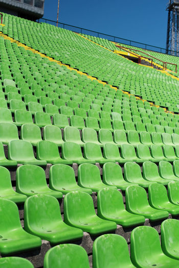 View of green chairs on stadium