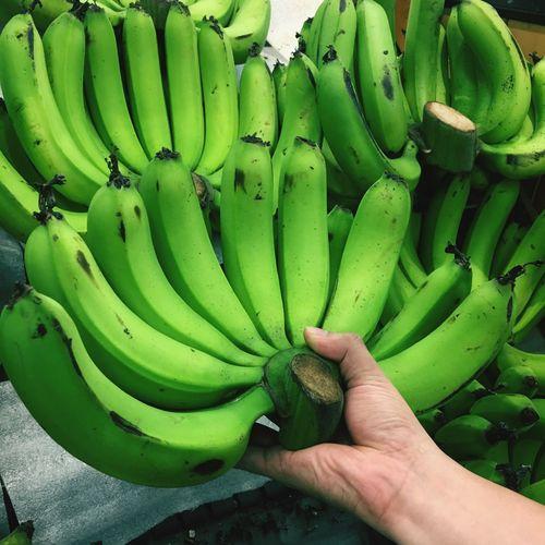 Cropped image of hand holding fruit at market