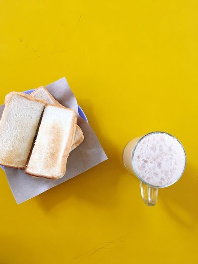 EyeEm Selects Yellow Indoors  Still Life Table No People Food And Drink Colored Background Yellow Background High Angle View Food Freshness Paper Copy Space Wall - Building Feature Healthy Eating Studio Shot Directly Above SLICE Wellbeing Bread