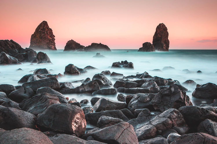 Stacks of Ciclopi, Acitrezza Sicily Rock Sea Rock - Object Solid Water Beauty In Nature Scenics - Nature Sky Sunset Long Exposure Tranquility Tranquil Scene Nature No People Land Rock Formation Motion Horizon Over Water Outdoors Catania Stacks  Ciclope Ulisse Acitrezza  Sicily