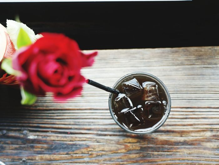 Directly above shot of cola served on wooden table