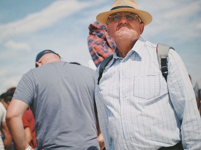 Defocused... Face Grimace Experience Street Fashion Looking Sunlight Old Man Urban City Street Social Event Confused Straw Hat Hat Real People Men Leisure Activity Lifestyles People Adult Males  Casual Clothing Glasses Outdoors Portrait Standing Waist Up Togetherness Front View