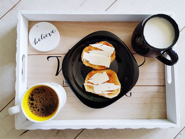 The Word Belive Food And Drink Healthy Eating Toasted Bread Toast With Butter Home Milk In Black Cup Black Cup Coffee In A White Cup Cup Of Coffee White Roses BreakfastTime  The Week On EyeEm Lifestyle Milk Coffee And Milk Old Fashion Style Coffee EyeEmNewHere Quality Cup Of Milk Freshness Breakfast Wonderful Life Belive Food Stories