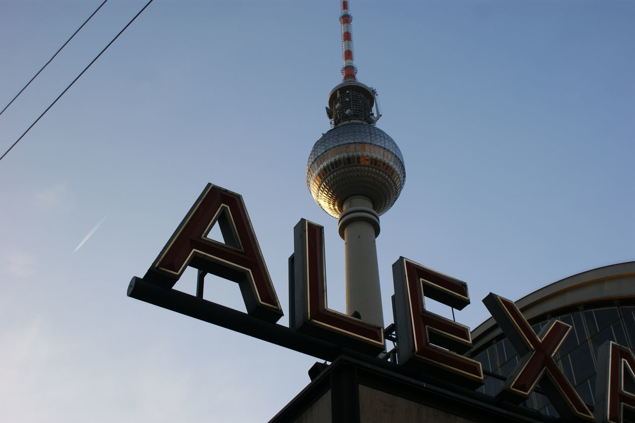 Low Angle View Of Text And Fernsehturm Against Sky