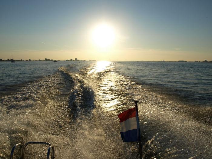 Sunset Speedboatride Speedboat On The River Motorboat Water Water Sea Sky Sunset Scenics - Nature Nature Horizon Horizon Over Water Sunlight No People Flag Sun Nautical Vessel Lens Flare