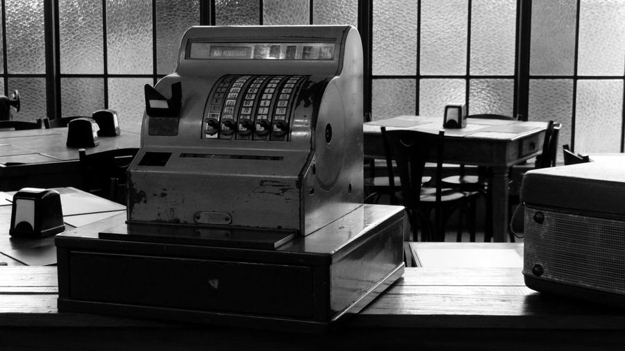 Close-up of old calculator in restaurant