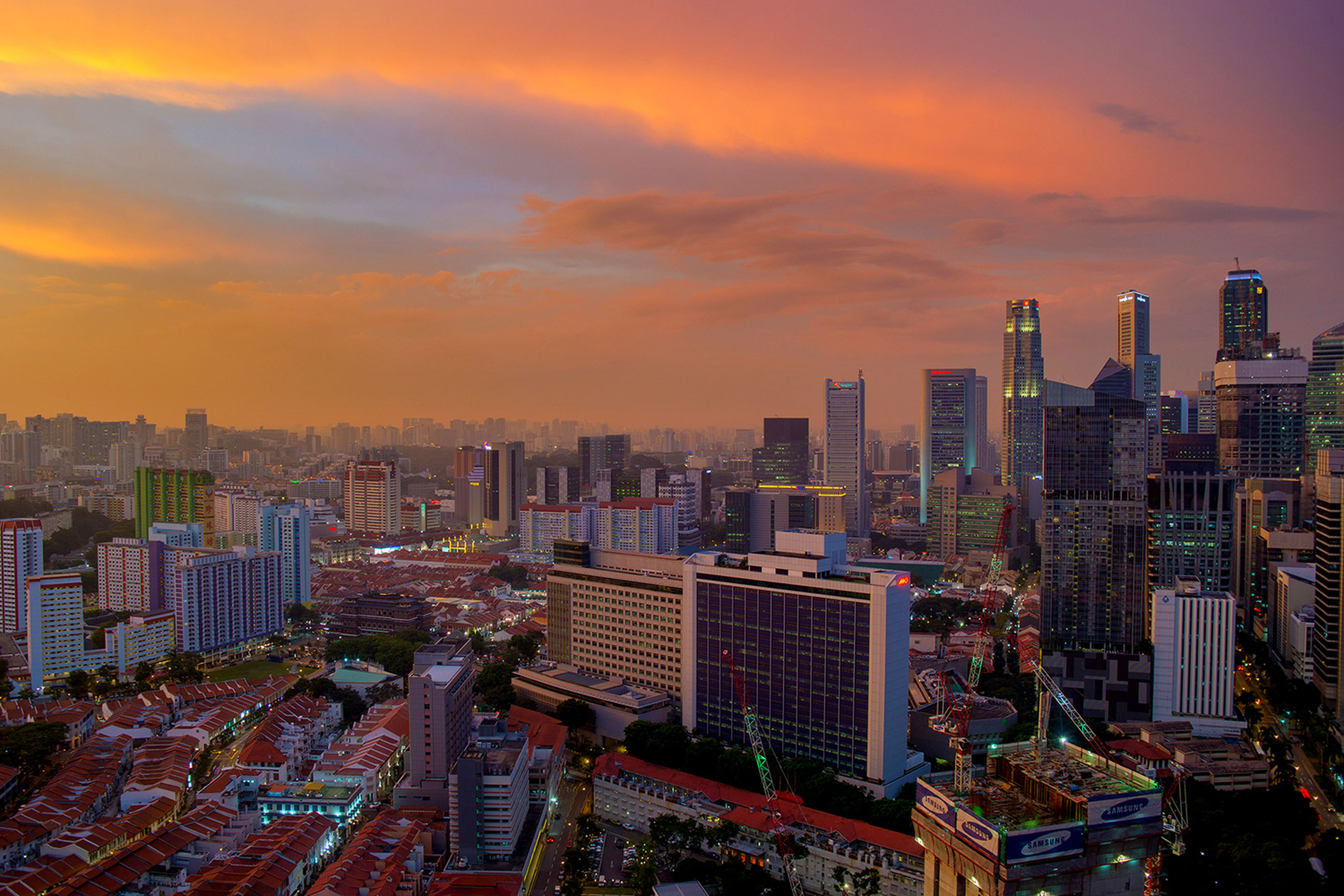 city, building exterior, architecture, cityscape, built structure, sunset, skyscraper, sky, high angle view, tower, crowded, tall - high, orange color, city life, modern, cloud - sky, office building, residential district, urban skyline, residential building