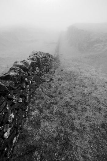 The Disappearing Wall Black & White Leading Lines Beauty In Nature Blackandwhite Day Drystone Wall Fog Landscape Mist Nature No People Outdoors Power In Nature Scenics