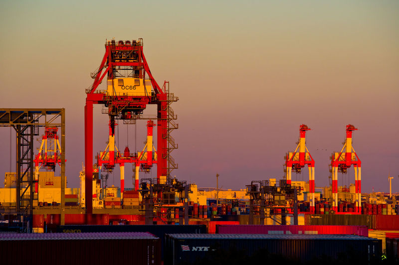 Gantry Cranes Industry Architecture Sky Pier Commercial Dock Sunset Machinery Orange Color Water Crane - Construction Machinery Freight Transportation Business Built Structure Container Shipping  Cargo Container Harbor Transportation No People Outdoors Construction Equipment Japan Tokyo Port
