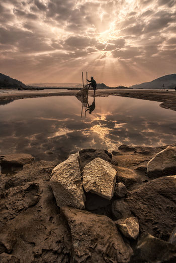 reflex of fisherman Fishing Fisherman Nature Water River Sunset Country Life Sky Cloud - Sky Rock Sea Beach Reflection Outdoors Solid Rock - Object Land Beauty In Nature