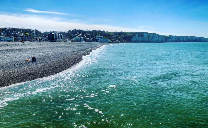 Blue sea, white cliffs and pebble beach of Fécamp, Normandy,France under a clear blue sky Water Sea Sky Nature Scenics - Nature Beauty In Nature Day Motion No People Blue Tranquility Tranquil Scene Outdoors Waterfront Land Rock Idyllic Non-urban Scene Solid