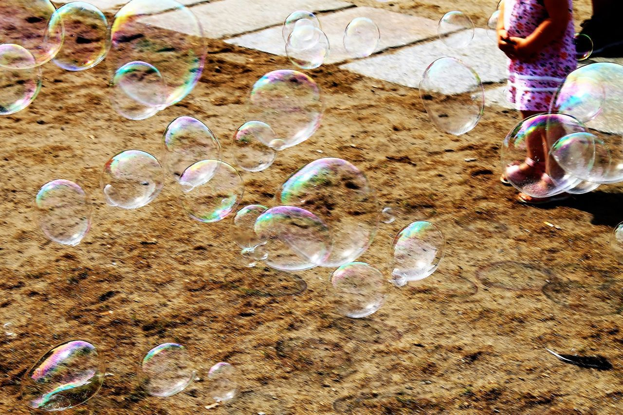 fragility, bubble, no people, bubble wand, science, close-up, beauty in nature, refraction, nature, spectrum, day, outdoors
