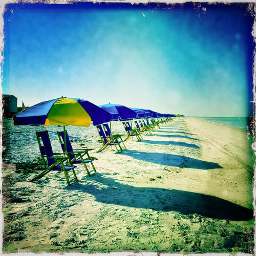 A moment of quiet before the beachgoers arrive Anticipating Beach Beach Chairs Beach Life Beach Photography Beach Time Beach Umbrellas Beachlife Beachphotography IPS2016StillLiife Blues IPS2016Blue Pattern Peaceful Quiet Before The Storm Sand Shadows Silence Before The Storm Sunny Day Umbrellas IPhoneography Hipstamatic Hipstography Hipstamaticaddicts