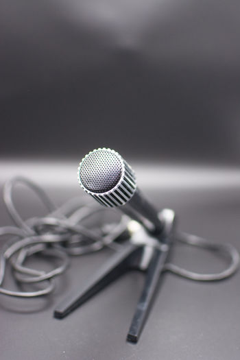 Microphone Microphone Stand,round,closeup,background,black,object,technology,old Microphone On Black Background,technique,music,recording,metal,plastic,light,sound,equipment Input Device Microphone Music Technology Communication Indoors  Metal Close-up Arts Culture And Entertainment Connection No People Gray Still Life Absence Studio Shot Equipment Selective Focus Audio Equipment Microphone Stand Performance Silver Colored Stage Aggression  Conference - Event