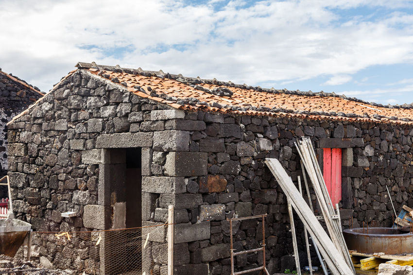 Azores Pico Island Traditional House Ancient Architecture Bad Condition Basaltic Rock Building Building Exterior Built Structure Cloud - Sky Damaged Day Deterioration History House Nature No People Old Outdoors Roof Roof Tile Ruined Sky Stone Wall The Past Travel Destinations Wall