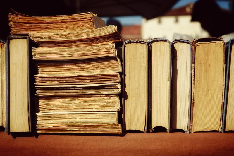Close-up of books on display at stall in flea market