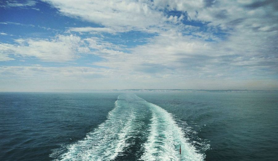 A view from the ferry between France and the UK. In the background you can see the UK. Sea Horizon Over Water Water Beauty In Nature Scenics Sky Surf Seascape Tranquility Nature Tranquil Scene Cloud - Sky Wake - Water Ocean Calm Wave Shore Blue Day Wake Uk Ferry Dover Dover England