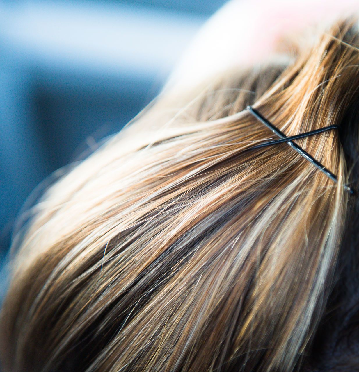 Close Up Of Human Hair With Hairpins