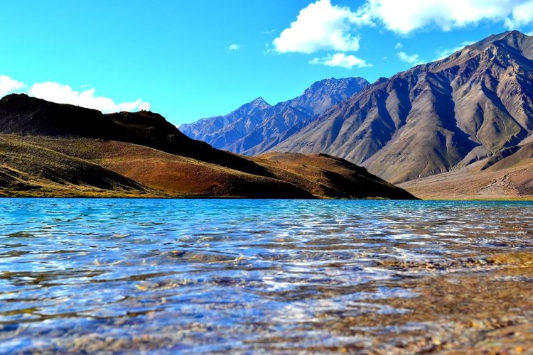 Scenic view of chandra taal lake against mountains at himachal pradesh