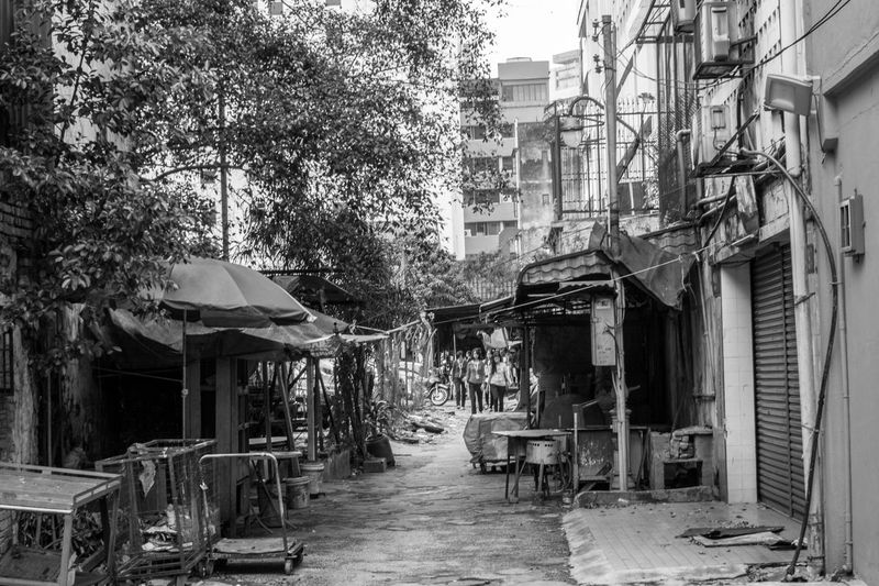 Empty alley with buildings in background