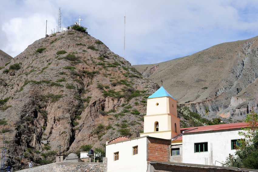 Andes Architecture Argentina Beauty In Nature Bell Tower Building Exterior Built Structure Cross Day Indigenos Iruya Mountain Nature No People Outdoors Place Of Worship Religion Sky Spirituality Whitewashed
