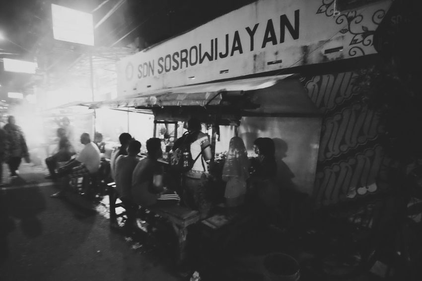 night snacks Aaaqhaaa Street Streetphotography Blackandwhite Photography Street Photography Streetlifestyle Large Group Of People Adult Occupation Men Real People Day