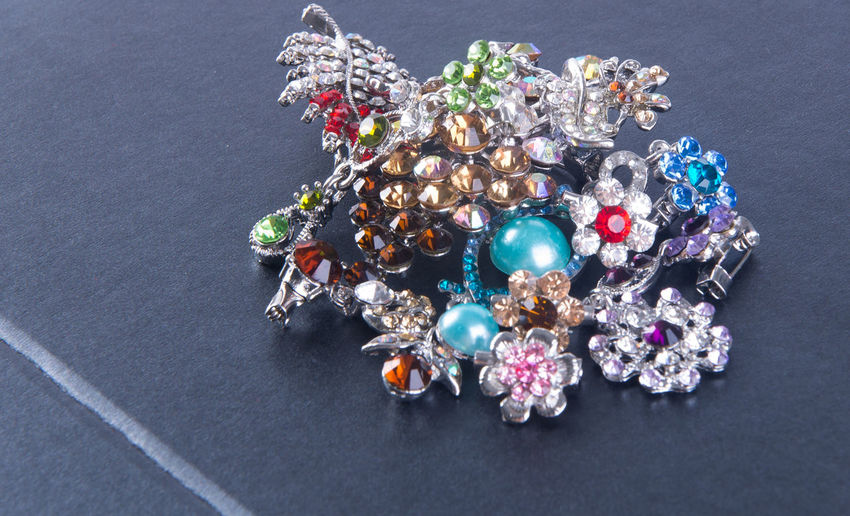 High angle view of brooch on black background
