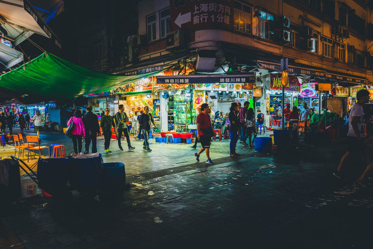 Group of people in city at night
