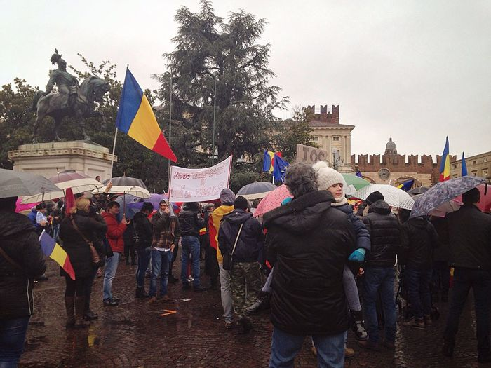 Romanian people from Verona, Italy protest against the Romanian Government One Year Project 2017 February 5 Romanians Protest Flag Large Group Of People Real People 36/365 Men Built Structure Lifestyles Patriotism Women Building Exterior City Crowd Leisure Activity Outdoors Sky Tree Social Issues Day Unity Togetherness