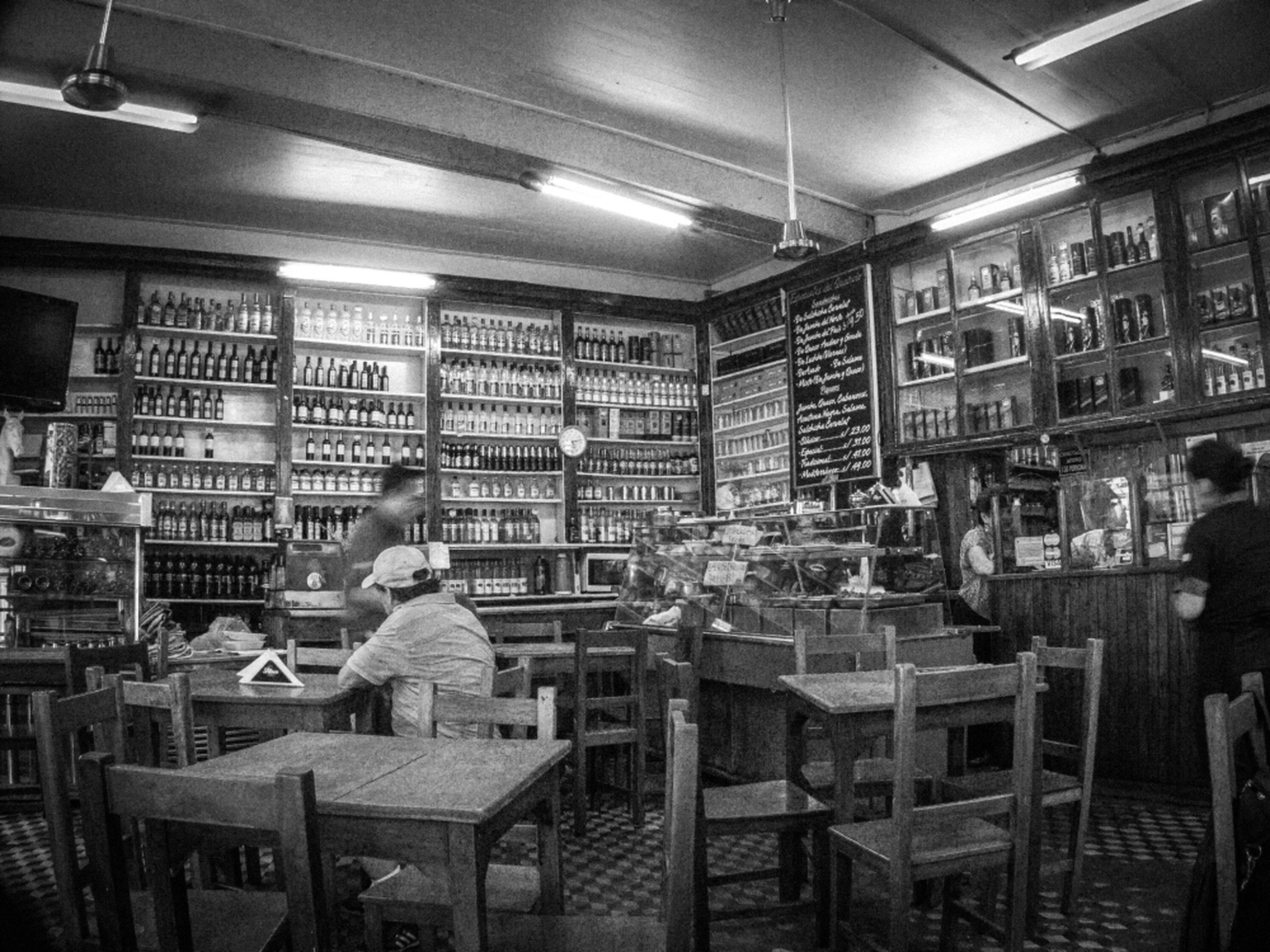 indoors, interior, chair, illuminated, empty, ceiling, store, window, absence, architecture, built structure, shelf, lighting equipment, restaurant, retail, incidental people, arrangement, shop, hospital, table