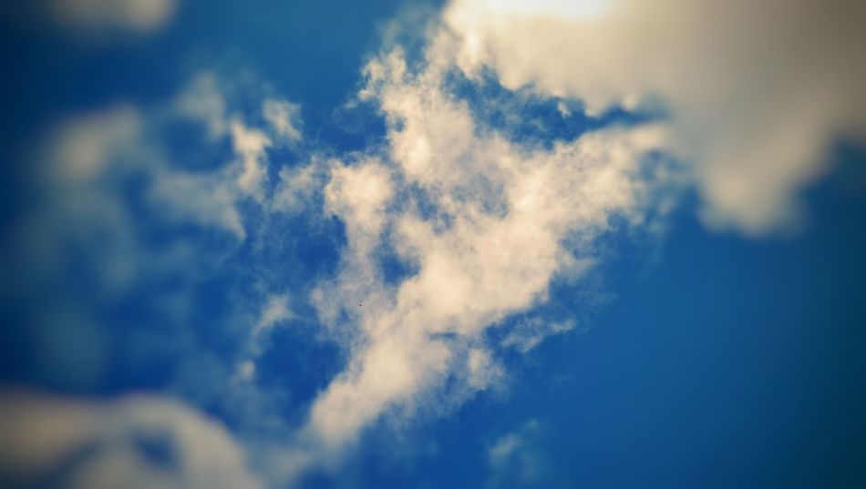 Two lovers kissing in the cloud