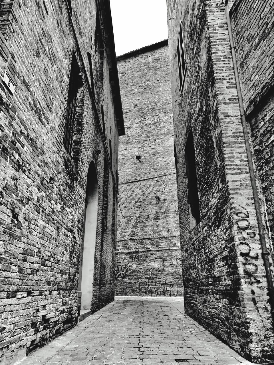 architecture, built structure, the way forward, direction, wall, wall - building feature, day, building exterior, brick wall, no people, brick, building, outdoors, old, footpath, narrow, the past, history, staircase, nature, diminishing perspective, stone wall, alley