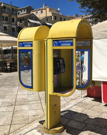 City Pay Phone Telephone Connection Communication Telephone Booth Old-fashioned Yellow Retro Styled Telephone Receiver Outdoors Day Telecommunications Equipment No People Convenience Technology Close-up Sky